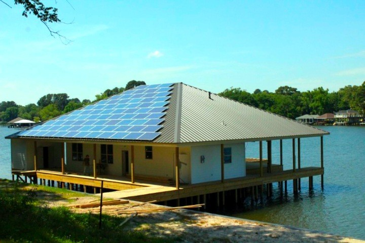 Solar panels installed on the roof of a boathouse delivers 18 kW of power.